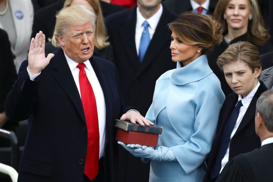 U.S.+President-elect+Donald+Trump+takes+the+oath+of+office+as+First+Lady-elect+Melania+Trump+stands+during+the+58th+presidential+inauguration+in+Washington%2C+D.C.%2C+U.S.%2C+on+Friday%2C+Jan.+20%2C+2017.+Donald+Trump+will+become+the+45th+president+of+the+United+States+today.++Photographer%3A+Andrew+Harrer%2FBloomberg+via+Getty+Images
