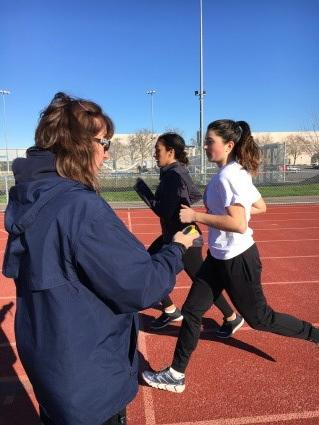 Coach James timing juniors Hannah Salinas and Hannah James
