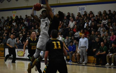 Tracy narrowly defeats West, 73-71