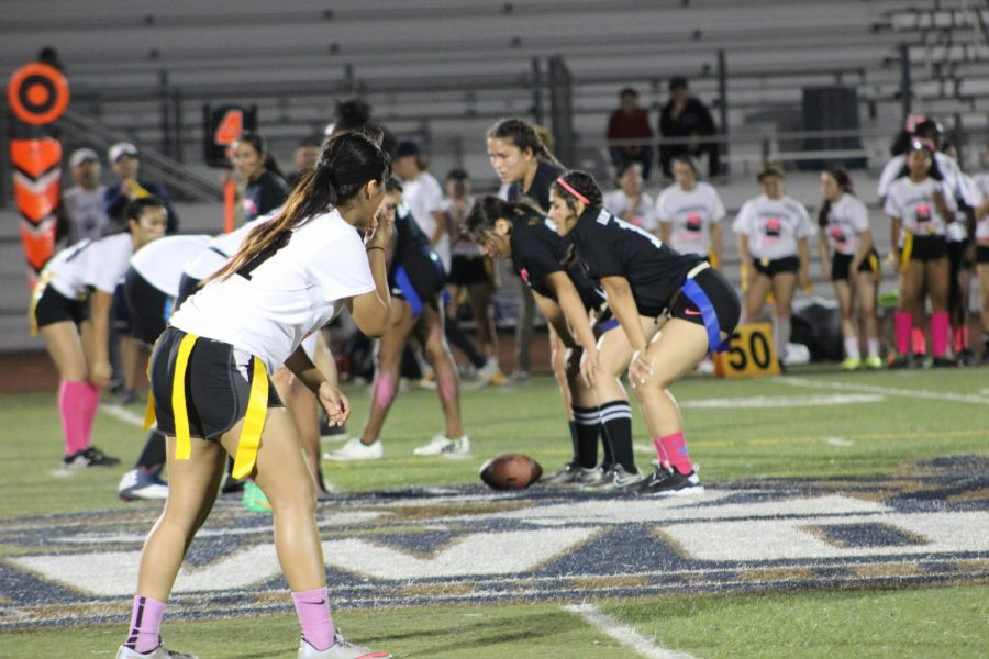 Senior powderpuff team prepares to hike the ball and kick off a play