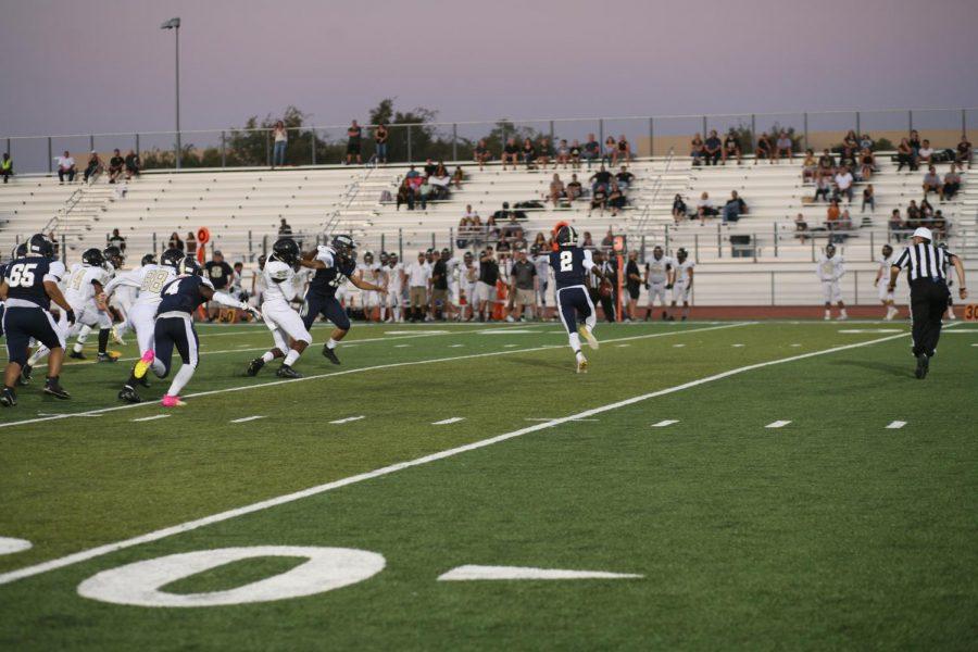 Senior+quarterback+Alfred+Robinson+looks+downfield.+Photo+by+Jonah+Guerrero