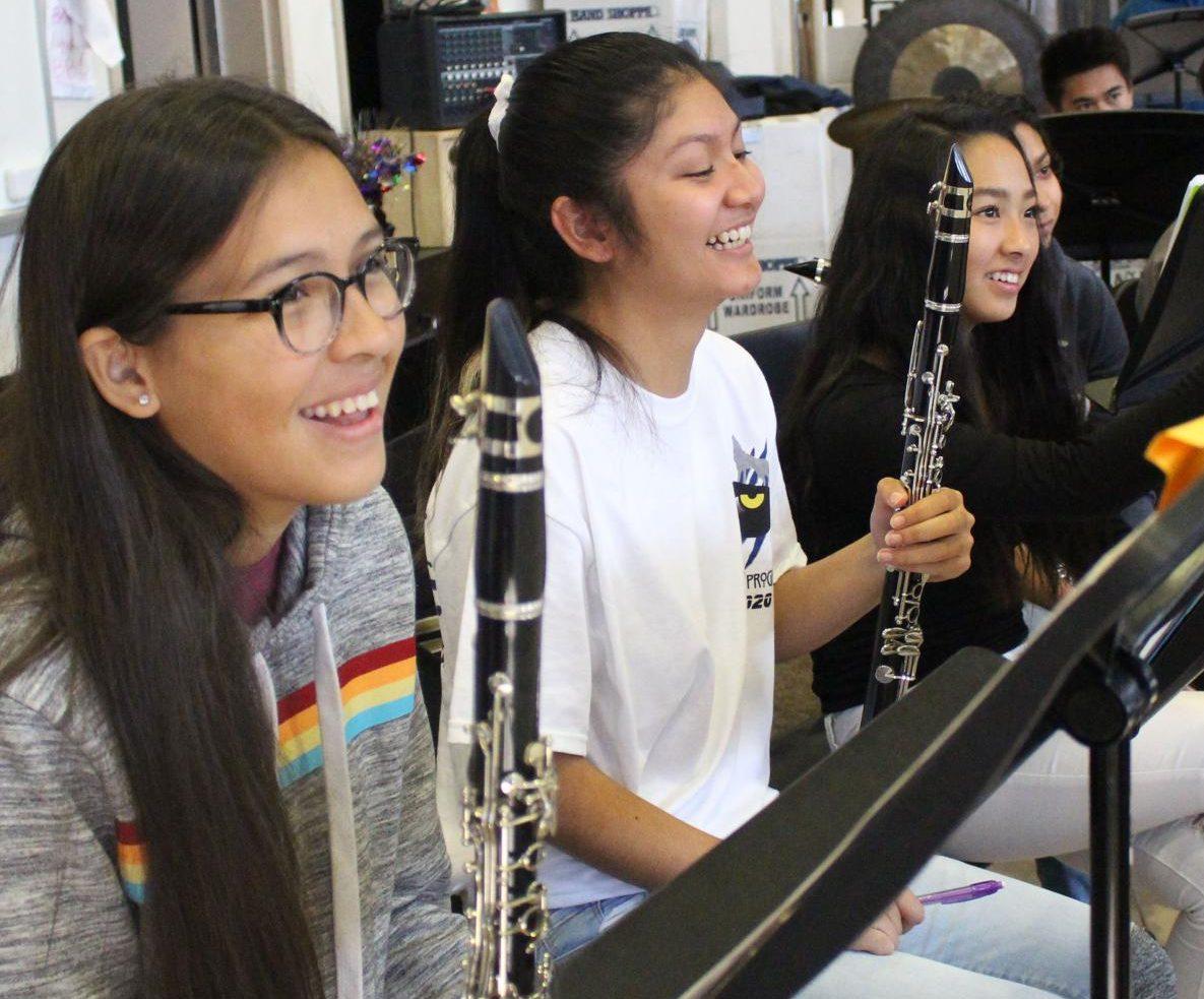 Clarinetists Fernanda Tapia, Jhasmine Barrett, and Roselyn Lazum enjoy the concert band class. Photo by Jovana Centeno.