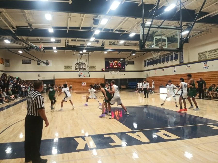 The+Boys+Varsity+basketball+team+fights+to+get+the+ball+on+November+22%2C+2019.+Photo+by+Isaac+Baria.+
