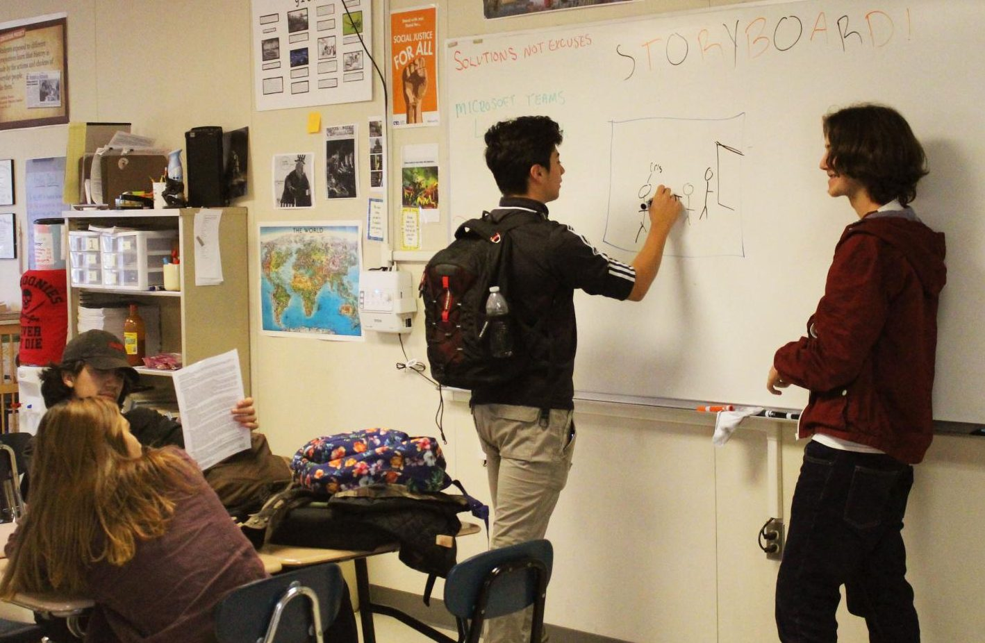 Seniors Regino Bernal and Robby Trammell sketch storyboard ideas. Photo by Cristopher Marin.